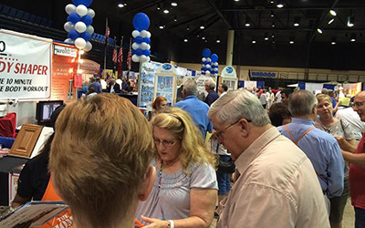 Crowds at Home Show booths 3